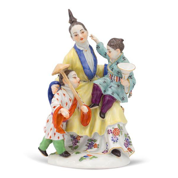 Meissen, gruppo in porcellana policroma