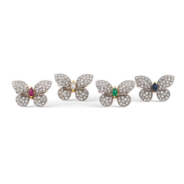 Quattro spille a farfalla in oro a due colori 18kt e diamanti