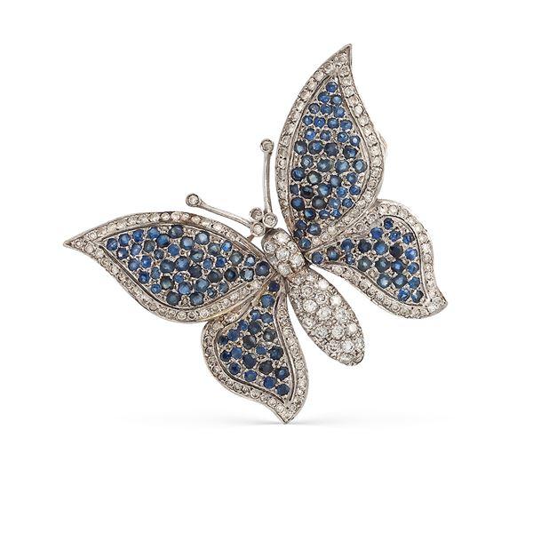 Spilla farfalla in oro bianco 18kt con zaffiri e diamanti