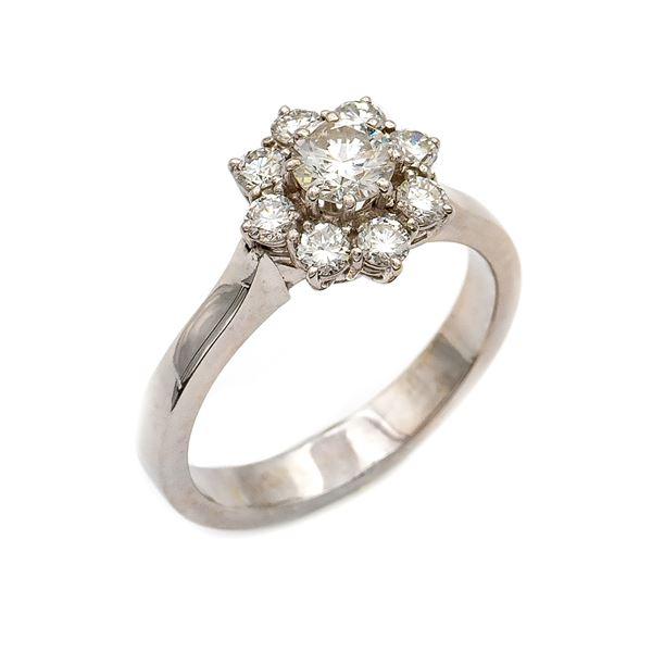 Anello fiore in oro bianco 18kt con un diamante